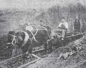 This photograph taken outside Letcher County's first commercial coal mine appeared on the front page of The Mountain Eagle's February 20, 1930 edition. The names of the people shown in the photo appear in the story below.