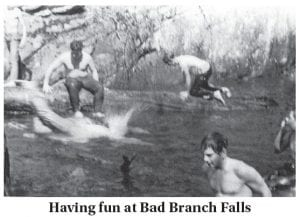 This photograph, believed to have been taken sometime in 1968, shows three Letcher County boys having fun in the cold water below Bad Branch Falls, located near the top of Pine Mountain at Oven Fork. Ronnie Smith is seen sitting on a rock at left while Jackie Estep is kneeling while climbing out of the water. At bottom right is Jimmy Craiger. The three attended Eolia Grade School and Whitesburg High School together.
