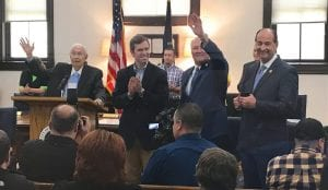 State Senator Johnny Ray Turner, second from right, reacted after Whitesburg Mayor James W. Craft, left, asked for a show of hands from retired teachers who attended a gathering at City Hall Monday that featured Governor Andy Beshear, second from left. At far right is Rocky Adkins, right, the former House majority leader who is now special advisor to Beshear. Gov. Beshear was here to announce grants for the city and Letcher County. (Eagle Photo)