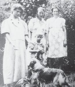 From left to right are Midge Shackleford Halcomb, Lida Lucas Banks with her son Fred, and Daisy Elswick.
