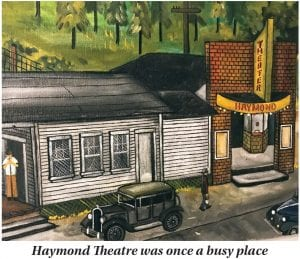 """Pictured above is a portion of a painting by highly-regarded Letcher County artist David Lucas depicting the old Haymond Theatre as it stood in the center of that once-bustling coal camp. Seventy years ago this month — on March 9, 1950 — the Haymond Theatre showed the movie """"Thunder in the Pines,"""" starring George Reeves and Greg McClure. The Haymond Theatre was one of at least four movie houses doing business in Letcher County at that time. Others were in Jenkins, Neon and Whitesburg."""