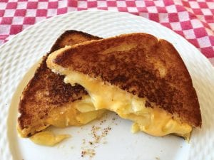 This photo shows a grilled cheese sandwich prepared using the method recommended below. (Elizabeth Karmel via AP)