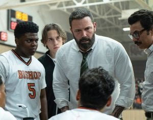 """From left, Charles Lott Jr., Ben Affleck and Al Madrigal appear in a scene from """"The Way Back."""" (Warner Bros. Pictures/AP)"""
