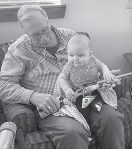 Tom Richardson is pictured with one of his great grandsons, Caiden McCool-Solis.