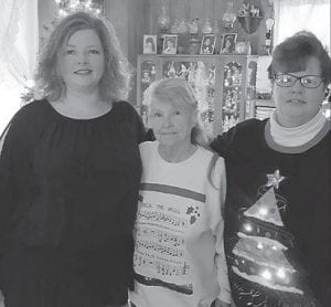 """Southern Ohio correspondent Rose Ballard says, """"Happy birthday to my daughter, Angie Wiederhold, March 23. Angie has reached the milestone of 55. My daughter, Anna Nottingham, is on my left, Angie Weiderhold with the Christmas sweater."""