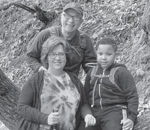 Donna Watts is pictured at Bad Branch Falls with Mike Watts (left) and Eli Gordon.
