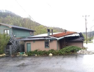 THE ROOF WAS RIPPED off Croucher's Service Center at Isom by high winds Sunday night.