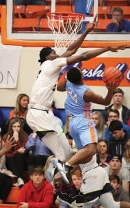 Moussa Cisse had 16 triple-doubles last season. He has always been a terrific shot blocker – he rejected this shot by five-star guard Daeshun Ruffin at the Marshall County Hoopfest – but also improved his offensive game last season. (Ann Beckett/Marshallcountydaily.com)