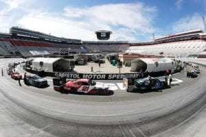 In this picture made with a fisheye lens, cars were readied for a NASCAR Xfinity Series auto race at Bristol Motor Speedway on Monday in Bristol, Tenn. (AP Photo/Mark Humphrey)