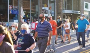 MARCHING WITH PROTESTERS – Whitesburg Police Chief Tyrone Fields walked down Main Street with protesters during a Black Lives Matter protest on Friday, June 12.