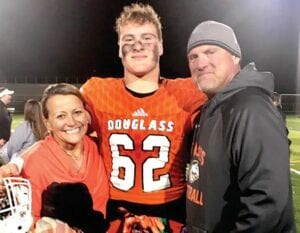 Jager Burton, the state's top-ranked 2021 recruit, was photographed with his parents last fall. He will play in the All-American Bowl Jan. 9 in San Antonio. (Frederick Douglass High photo)