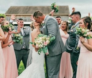 Kentucky offensive tackle Landon Young married Haleigh Johnson Young despite the COVID-19 restrictions and got plenty of cheers from the wedding party. (Betty Lea Photography)