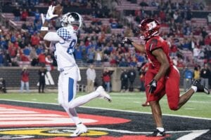 In this Nov. 24, 2018 file photo, Kentucky wide receiver Josh Ali (82) catches a touchdown pass during the team's NCAA college football game against Louisville. The Southeastern Conference's conferenceonly scheduling decision during the coronavirus pandemic wiped out any hopes of saving four in-state rivalries against Atlantic Coast Conference opponents, all traditionally played on the final Saturday of the regular season. (AP Photo)