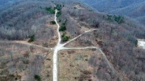 THE NEW LETCHER COUNTY AIRPORT would be built here on an old Redfox Coal strip mine known as Sunset. This aerial photo is looking South along the location of the proposed runway.