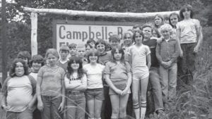 PICTURES WORTH 1,000 DREAMS — Student photographers stand outside Campbells Branch Elementary School, posing to have their own photo taken in the mid-1970s. A film about their experiences in a photography class and how it impacted their lives appears on PBS's longest running documentary show, POV Docs, at 10 p.m. on Monday.