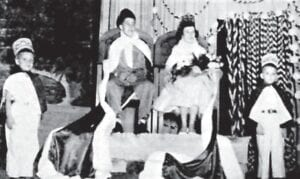 HALLOWE'EN CARNIVAL KING AND QUEEN —Whitesburg High School King and Queen were crowned at Hallowe'en Carnival. King Eugene Sparks is the son of Mr. and Mrs. Ismay Sparks, Mayking. Queen Eva Lou Everidge is the daughter of Mr. and Mrs. Ishmael Everidge, Millstone. The pages are Jimmy Combs and Forrest Carl Brown.