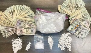 DRUGS AND MONEY — While federal officials focus on opioids such as oxycodone and hydrocodone, the drug of choice in Letcher County is now meth, police say. Pictured, a bag containing 1.12 pounds of methamphetamine, more than 250 Xanax pills and thousands of dollars was confiscated during an arrest last week. (Photo courtesy Letcher County Sheriff 's Department)
