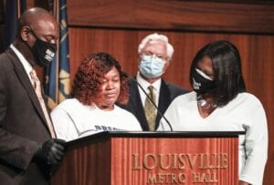 Tamika Palmer, mother of Breonna Taylor, center, spoke during a news conference Tuesday in Louisville. (AP Photo)