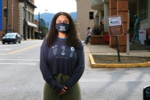 Dayja Hogg, 19, stands for a portrait near the Letcher County Courthouse. Following the deaths of George Floyd in Minneapolis and Breonna Taylor in Louisville, Hogg helped organize a protest in her hometown of Whitesburg where she grew up experiencing racism. (AP Photo/Brian Blanco)