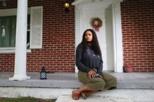 Dayja Hogg sits in front of her home in Whitesburg. (AP Photo)