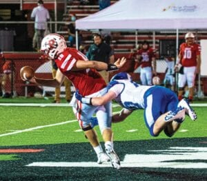 Letcher Central sophomore Cooper Bailey wraps up Perry Central quarterback Charles Mullins in the district win on the road.