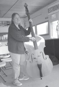 Vicki Abbott played the huge stand-up bass at Old Time Fiddler's. By the smile on her face, she was enjoying playing it.