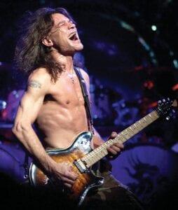 Van Halen guitarist Eddie Van Halen performs in Phoenix in August 2004. Van Halen, who had battled cancer, died Tuesday. He was 65. (AP Photo)