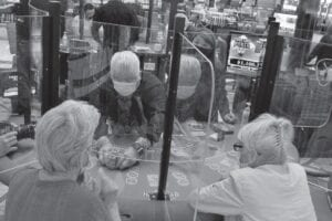 See-through barriers separate gamblers and a dealer at a card table at the Hard Rock casino in Atlantic City, N.J. American Gaming Association President Bill Miller said this week that the industry is adapting to the pandemic but needs assistance from the government for its casinos and workers. (AP)