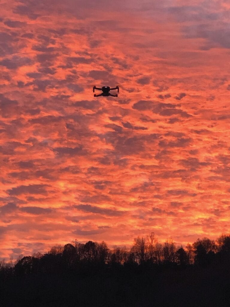 """L.M. """"Mike"""" Caudill captured this photograph of a drone being flown over Whitesburg during a beautiful evening sunset."""