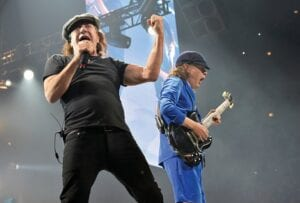 "Brian Johnson, left, and Angus Young, of AC/DC, are pictured here performing in 2016 in Chicago. After 47 years, the band has released its 17th studio album, ""Power Up."" (Invision/AP)"