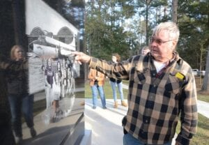 """Gene Odom (above), one of the survivors of the October 20, 1977, plane crash that killed members of the band Lynyrd Skynyrd, points to where he was sitting in the band's doomed airplane at the Lynyrd Skynyrd monument near the crash site near Gillsburg, Mississippi. The rock band famous for """"Sweet Home Alabama"""" and """"Free Bird"""" now has highway signs pointing to the site of the plane crash that claimed the lives of some of its members, including singer and band leader Ronnie Van Zant (left). (Matt Williamson/The Enterprise-Journal via AP)"""