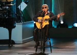 """Musician Jose Feliciano, seen here performing during the Library of Congress Gershwin Prize tribute concert in 2019 in Washington, is celebrating 50 years of his bilingual Christmas classic """"Feliz Navidad"""" by releasing a new version featuring Jason Mraz, Lin-Manuel Miranda, Shaggy and more. (Invision/AP)"""