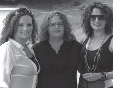 Tina Greene McElroy stands with her daughters Melena Outlaw and Mandy Stamper. Tina McElroy's birthday was November 30.