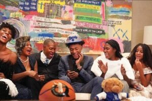 Immanuel Quickley, center, and his family on the phone with Kentucky coach John Calipari after he had been picked in the first round of the NBA draft and then traded to the New York Knicks.