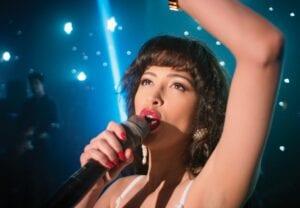 "Christian Serratos portrays Selena Quintanilla from ""Selena The Series,"" premiering Dec. 4 on Netflix. (Netflix via AP)"