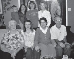 Alpha Profitt is pictured with her children, Teresa Glispie (holding a grandchild), Velma Caldwell, Joyce Baker, Becky Hipps, Phyllis Campbell, and the late Wayne Profitt.