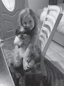 """Eight-year-old Harlow Gray holds Chewy. Harlow is a granddaughter of Kay Gray, and great-granddaughter of Rose Ballard. Harlow spent the night with Kay. She slept with Kay, and when Kay turned over, Harlow touched Kay's face and said, """"Oh, Mamaw, you have a little wrinkle on your face."""" Then she asked, """"Mamaw, how old are you?"""" Kay answered 57. Harlow thought just a second then said, """"Mamaw, you are almost 60."""""""