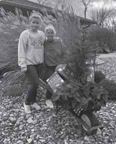 """""""My mom is at it again. She loves this Christmas tree so she's trying to steal my other wheelbarrow. I think she asked Kate to help her this time,"""" wrote Kay Gray, Rose Ballard's daughter."""