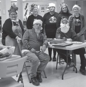 Pictured (left to right) are Gwen Johnson, Roy Tackett, Michelle Bentley, Evelyn Rose, Mandy Fleming, Mary Sturgill, and Jayden Sturgill (seated group).