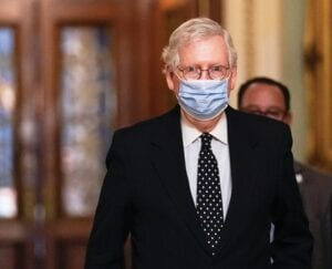 Senate Majority Leader Mitch McConnell walks from the Senate floor to his office on Capitol Hill in Washington in this recent photo. (AP Photo)