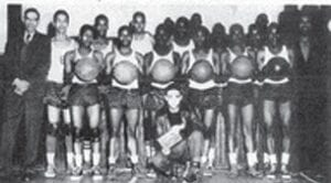 DUNHAM BLUE DEVILS — Back row (left to right) G.W. Parks, Principal, Edward Oden, Edward Owsley, Curtis Crenshaw, Frank Ward, Tommy Bass, George Lamarr, P.B. Cornettt, Coach, front row, Morris Coleman Donald Hudson, Willie Coleman, James Chance, Bobby Hooks and Arthur Davis. Scorekeeper kneeling in front, Marshall Epps.
