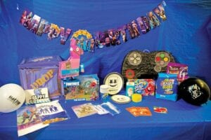 Pictured above is a party package supplied by The Birthday Fairy, a Letcher County nonprofit organization. The package includes decorations, gift cards for pizza and other items needed for a birthday celebration. The organization's efforts are funded entirely through fundraising and donations and aims to benefit those in need.