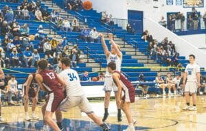 Nine-year-old Christopher Anderson Jr. captured this photograph of Letcher Central junior JD McDannel shooting a free throw during the Cougars' February 25 game with Knott Central. Also pictured for Letcher Central are Cooper Bailey (34) and Max Roark (30). The Cougars bounced back from the 72-52 loss to the Patriots with an 88- 53 win over homestanding Powell County on February 26. LCC's won-loss record stood at 8-8 going into Tuesday night's game at Leslie County. Christopher Jr. is the son of Mountain Eagle contributor Chris Anderson.