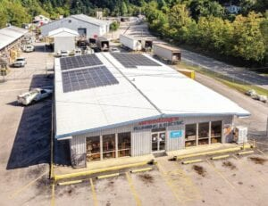 Solar panels can be seen on the roof of Breeding's Plumbing & Electric of Isom, one of three Letcher Countyfirms that have obtained grants to go solar.