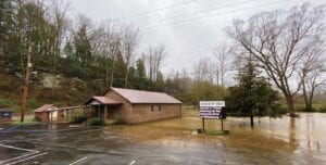 An electronic sign outside Church of Christ near the mouth of Cram Creek, Mayking, cautioned residents that the National Weather Service in Jackson had issued flood warnings for Whitesburg and Letcher County. The warning proved to be correct, as can be seen by the brown water that spilled over the banks of the North Fork of the Kentucky River and flooded the church's well-kept grounds and parking lot. (All photos this page by Chris Anderson and Ben Gish)