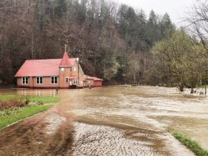 The Old Regular Baptist Church at Mayking was still surrounded by floodwaters from the North Fork of the Kentucky River when this photo was taken early Sunday afternoon.