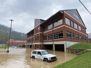 Floodwaters from the Kentucky River's North Fork took over the parking areas associated with the Letcher County Health Department in downtown Whitesburg. The waters also covered a portion of nearby Jenkins Road, leaving it largely impassable.