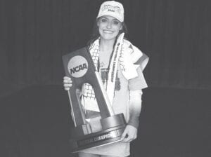 NCAA Women's Volleyball Tournament Final Four Most Outstanding Player Madison Lilley holds the national championship trophy after UK beat Texas for its first national title. She said players felt the BBN love all the way in Omaha during the tourney. (UK Athletics Photo)