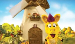 """This image shows the puppet Donkey Hodie from the new series, """"Donkey Hodie,"""" inspired from characters in the original Fred Rogers TV show.The whimsical series for children ages 3-5 started airing this week on KET and centers on the adventures of Donkey Hodie, an enthusiastic yellow donkey with a bright magenta mane. (Fred Rogers Productions/PBS via AP)"""