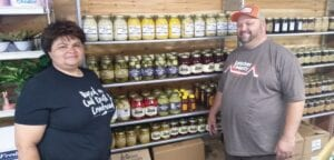 POLLY'S PICKLES – Markie and Randy Polly are shooting for the moon with a family recipe for mixed pickles and pickled corn. They plan to have the product in seven stores by today, and hope to have it in 40 by January. (Photo by Sam Adams)